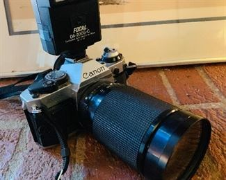 Canon 35mm, AE-1 with lens, flash, strap and case.
