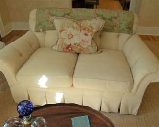 Two-place upholstered loveseat