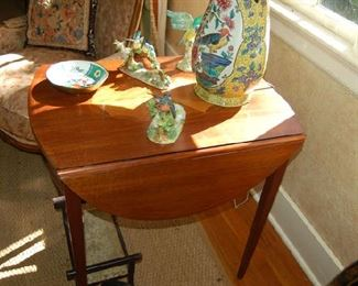 Inlaid drop leaf table by Baker