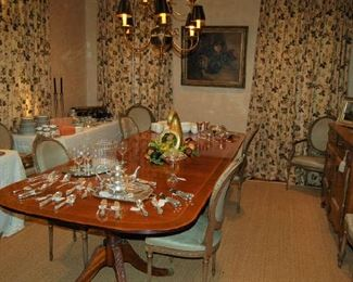 Beautiful double-banded, triple pedestal banquet table with leaves; curtains also for sale
