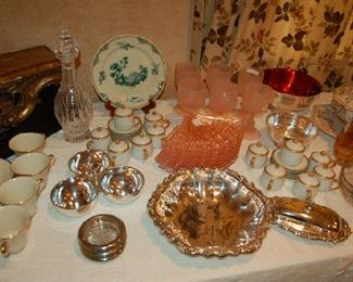 Tables of glassware and silver-plate