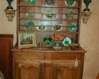 Good collection of majolica in early 19th Century cabinet