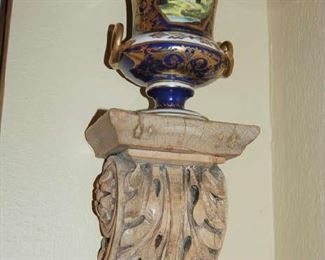 Pair of carved wall brackets with porcelain urns