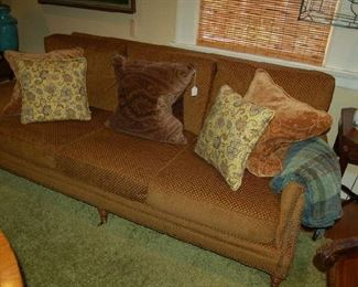 Three-place upholstered sofa and custom pillows