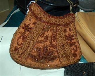 Beaded purse among name brand handbags