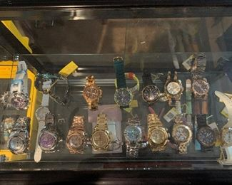 More Invicta watches, both men and women's