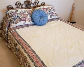 nice bed with metal headboard