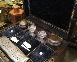 19th century travel vanity case with glass bottles.