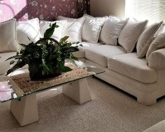 Wonderful immaculate sofas in this home and modern side table and coffee table.