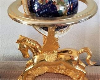 Beautiful gold horse with globe