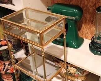 Gold Metal and Glass Display Table with Green KitchenAide and Blender