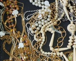 Large amounts of vintage costume jewelry & real jewelry. Due to the vast amount of jewelry all of it is not priced. Pick out the pieces you want, I'll price them.. we will agree on a price &  they'll be bagged up and sent to the cashier with a total. Thank you for understanding. Kelly
