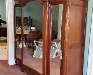 "96"" Antique Armoire with bevel mirror doors, solid walnut. Easy knock down into apx. 15 pieces and reinstallation. Has been refinished with custom shelves inside. In excellent condition. $2200"