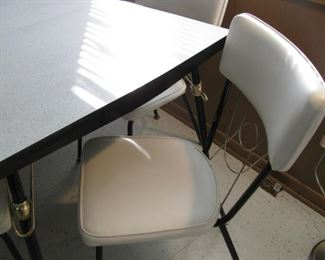 Retro Table and White Leather Chairs