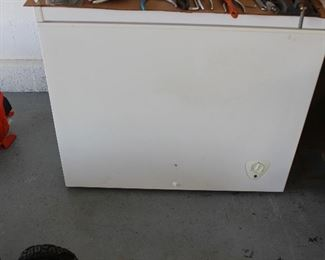 Freezer with drain plug