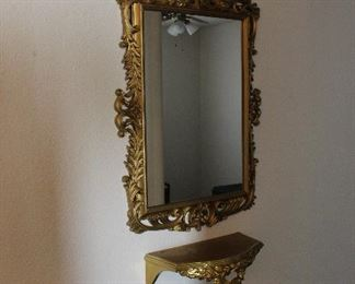 gold mirror and shelf