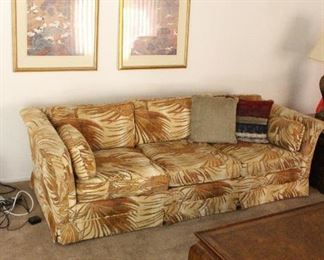two matching designer couches