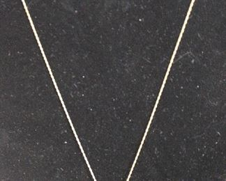 Gold chain necklace with stone