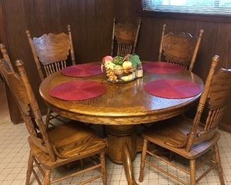 Oak reproduction claw foot table and 6 chairs - plus leaf!!