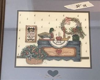 one of several cross stitched pieces
