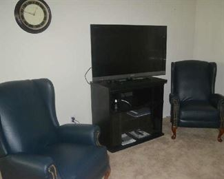 wing back recliners, flat screen television, media stand
