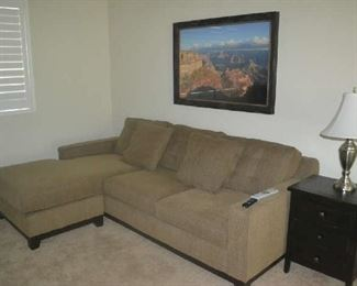 sectional with sleeper, end table, wall décor, table lamp