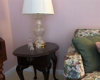 One of two solid wood side table, crystal lamp, Waterford bell, Mikasa bell
