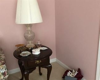 One of two solid wood side tables, crystal lamp and more