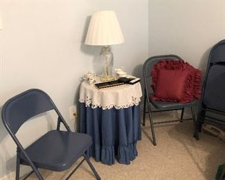 Two of 5 folding chairs, small round table, lamp