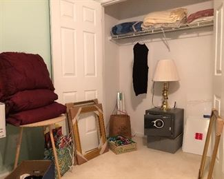 Three large, gold frames,  bows and Christmas bags, Sentry safe, brass lamp, afghan, blankets and more