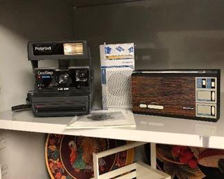 "Polaroid One Step ""Close-Up"", Transistor radios, metal trays, wood basket"