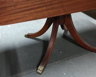 Wood dining table with two fold-down leafs. Detail of lion foot ornaments.