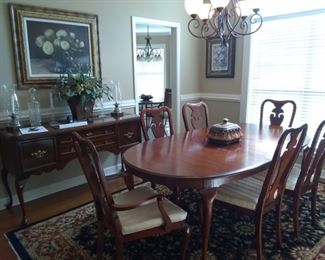 Dining room table and chairs with matching buffet