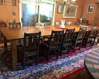 Oak dining table with twelve chair and two extra leaves.