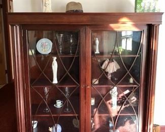 Mahogany two door cabinet with claw feet