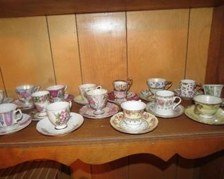 DOZENS OF DEMITASSE CUP AND SAUCERS.