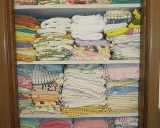 CLOSET FULL OF TOWELS.