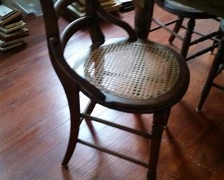 4 cane chairs table