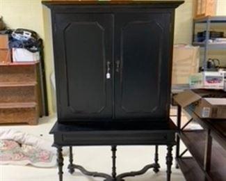 Two piece black matte wood bar...hutch opens to mirrored bar w/storage drawers , wine glass racks, etc.