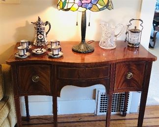 """Mahogany brandy board (small server) from Baker Furniture """"Historic Charleston Collection"""" (42""""L, 33""""H, 18""""D at center) Also antique chocolate set, cut crystal pitcher & silver plate pickle caster."""