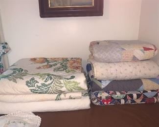 Cross stitch bedspreads and homemad quilts