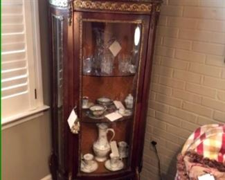 Beautiful lighted French curio with curved glass