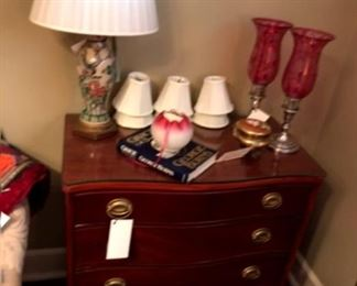 Mahogany bachelor's chest with oriental lamp and pair of sterling and cranberry hurricane lamps