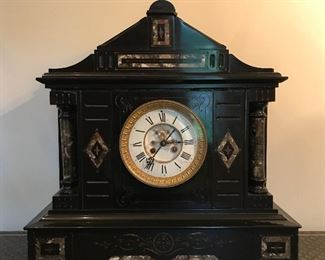 Antique French black slate and marble inlay clock with open escapement in excellent working order.