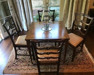 Many beautiful rugs, tables, and chairs of all ages and sizes.  Set of six hand carved late 19th or early 20th century Chippendale Revival 'ribbon back' dining chairs,  with pierced serpentine slats, H-stretchers, and straight Marlborough legs.