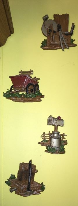 Various vintage wall decor by Sexton