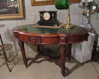 desk with green leather top , antique french clocks