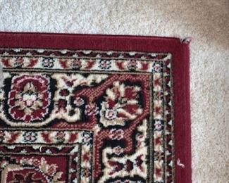 2 matching Burgandy  rugs