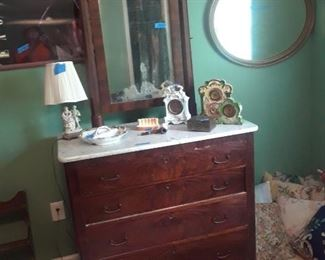 Four-drawer marble top dresser with mirror