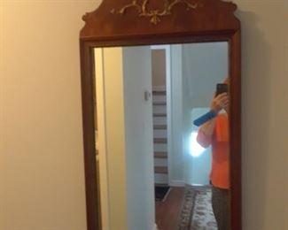 Mahogany mirror with embellishment at top